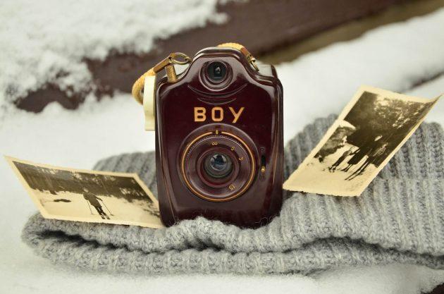 A camera sat on a blanket.